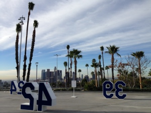 A view of the downtown skyline from Dodger Stadium's Top Deck, with relocated palm trees in the foreground.