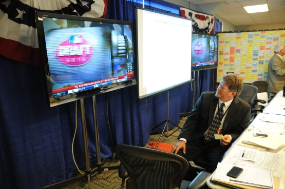 Dodgers VP of Amateur Scouting Logan White in the draft war room in 2013.
