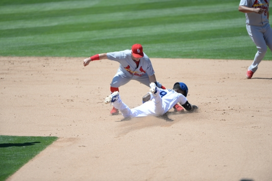 Dee Gordon steals second base agains the Cardinals on June 29.