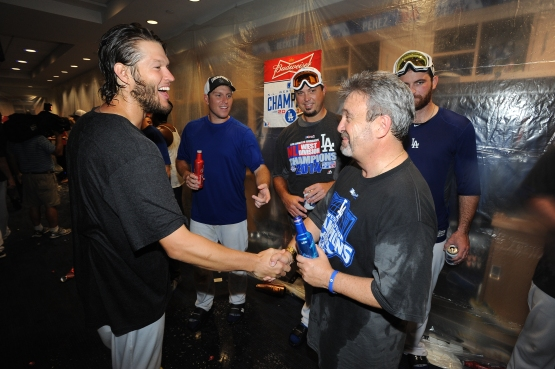 Clayton Kershaw and Ned Colletti congratulate each other after the Dodgers clinch the NL West on September 24. (Jon SooHoo/Los Angeles Dodgers)