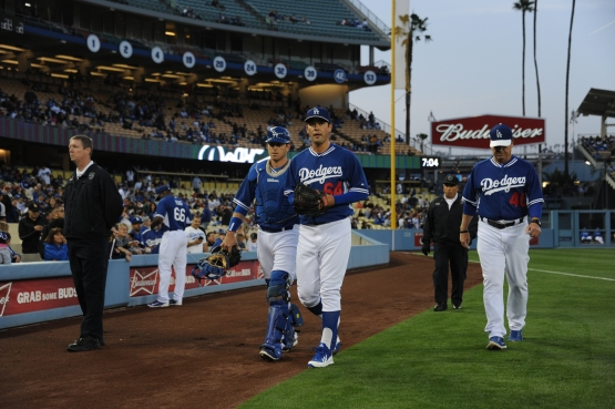 Zach Lee walks to the Dodger dugout after warming up at Dodger Stadium on March 28.