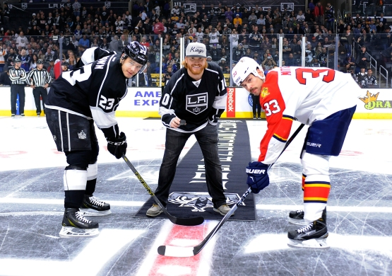 Justin Turner gets ready to drop the ceremonial puck between the Kings' Dustin Brown and the Panthers' Willie Mitchell. (Juan Ocampo/Los Angeles Dodgers)