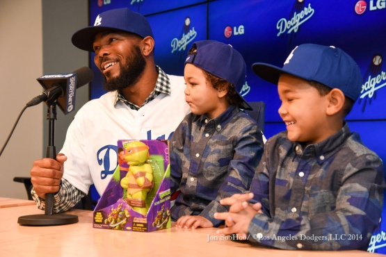 Howie Kendrick with his sons Tyson and Owen on Friday at Dodger Stadium.