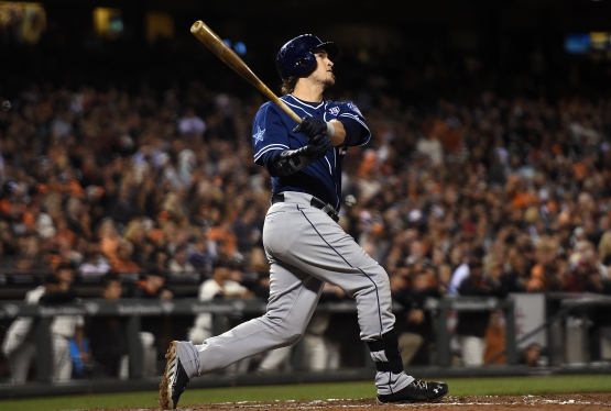 Yasmani Grandal hits a grand slam home run at AT&T Park on September 25 in San Francisco. The home run was Grandal's second of the game.  (Photo by Thearon W. Henderson/Getty Images)