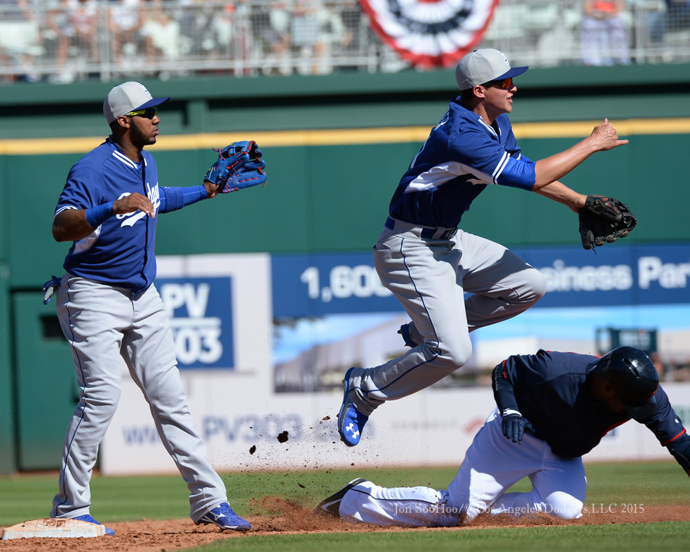 Young shortstop Corey Seager turns one of two double plays in Saturday's 5-5 tie with the Indians, as Erisbel Arruebarrena stands by at second base.