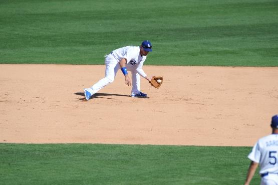 Alex Guerrero makes a play at third base on March 10. (Jon SooHoo/Los Angeles Dodgers)