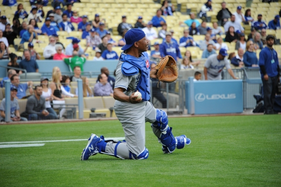 Though he caught only six games in a 15-year career, Derrel Thomas embraces the opportunity to go behind the plate, such as at the Dodgers' Old-Timers Game on May 16. (Juan Ocampo/Los Angeles Dodgers)