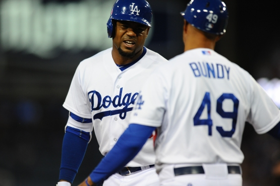 Carl Crawford injured himself April 27 while hitting his only triple so far of 2015. (Juan Ocampo/Los Angeles Dodgers)