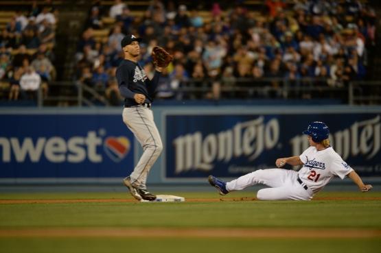 Zack Greinke steals second base on May 27 (Jon SooHoo/Los Angeles Dodgers)