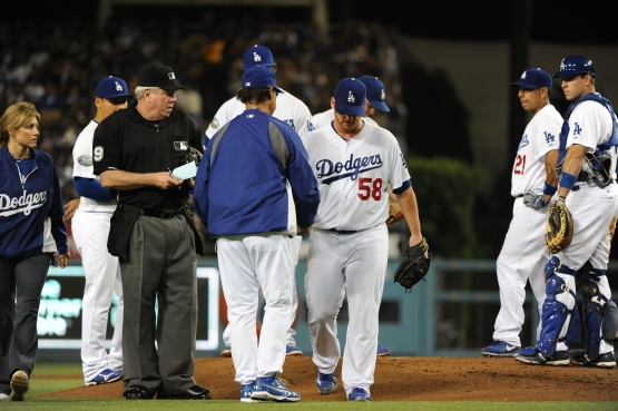 An injured Chad Billingsley leaves the game on August 24, 2012. (Jill Weisleder/Los Angeles Dodgers)