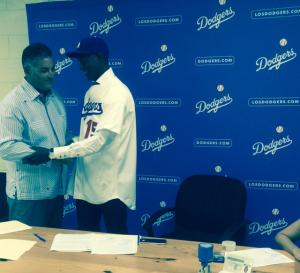 Dodger scout Patrick Guerrero congratulates Yadier Alvarez.