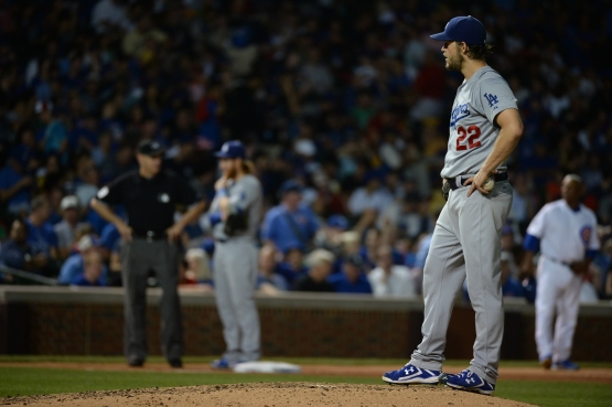 Clayton Kershaw waits out a stadium lighting delay in Wrigley Field on June 22. (Jon SooHoo/Los Angeles Dodgers)