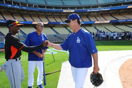 Dee Gordon says hello to Don Mattingly in his first game at Dodger Stadium as a Miami Marlin on May 11, as Lorenzo Bundy observes. (Juan Ocampo/Los Angeles Dodgers)