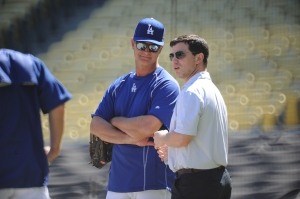 Don Mattingly and Andrew Friedman chat at an October 7 workout. (Jon SooHoo/Los Angeles Dodgers)