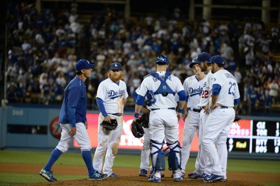 Don Mattingly visits Clayton Kershaw at the mound before leaving him in to finish the Dodgers' September 2 victory over the Giants (Jill Weisleder/Los Angeles Dodgers)