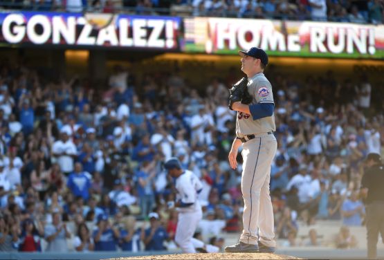 Matt Harvey reacts to a solo home run by Adrian Gonzalez at Dodger Stadium on July 4. (Photo by Harry How/Getty Images)