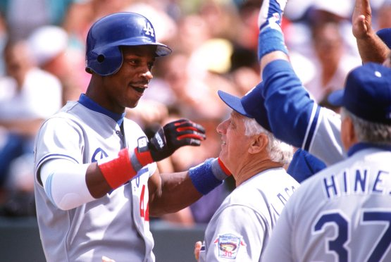 Darryl Strawberry and Tommy Lasorda in 1992. Otto Greule/ALLSPORT/Getty Images