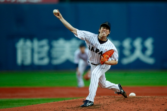 Kenta Maeda pitches in the second inning against the MLB All-Stars at the Kyocera Dome during the Japan All-Star Series on November 12, 2014 in Osaka. (Yuki Taguchi/MLB Photos)