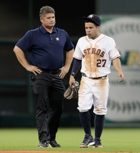 Jose Altuve of the Astros is attended to by trainer Nate Lucero in 2014. (Bob Levey/Getty Images)