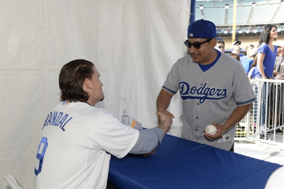 Yasmani Grandal signs for a fan at the 2015 FanFest. (Jill Weisleder/Los Angeles Dodgers)