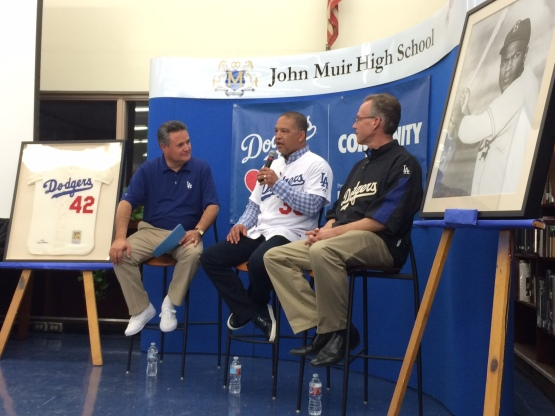 Jorge Jarrin, Dave Roberts and Mark Langill address students at Muir High School.