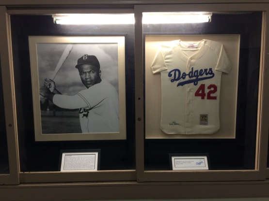 The Dodgers today present Muir with a framed photo and replica uniform of the school's most famous alum.