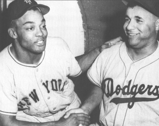 "Monte Irvin congratulates Roy Campanella on his 1951 NL MVP Award (""Baseball Hall of Gamers of the Negro Leagues - Monte Irvin."" via the State of New Jersey)"
