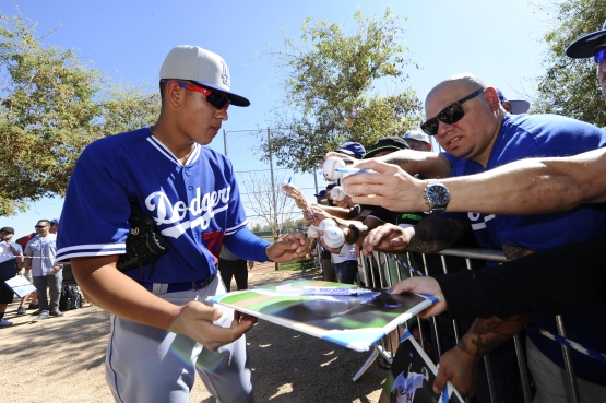 Julio Urias signs autographs at Spring Training in 2015. (Juan Ocampo/Los Angeles Dodgers)