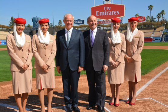 Sir Tim Clark, President of Emirates Airline and Dodger President Stan Kasten, pose with Emirates staff Ben Platt/MLB.com