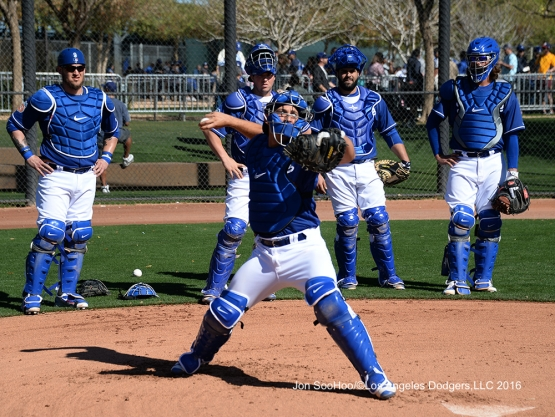 Los Angeles Dodgers Austin Barnes throws to second during workout