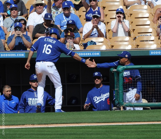 Andre Ethier is greeted by Dave Roberts after scoring the Dodgers' second run of the season. (Jon SooHoo/Los Angeles Dodgers)