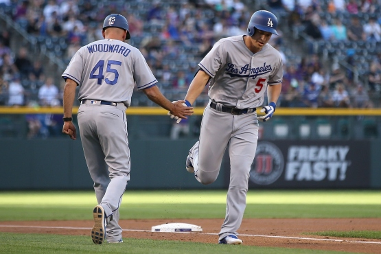 Corey Seager is congratulated by third-base coach Chris Woodward. (Doug Pensinger/Getty Images)