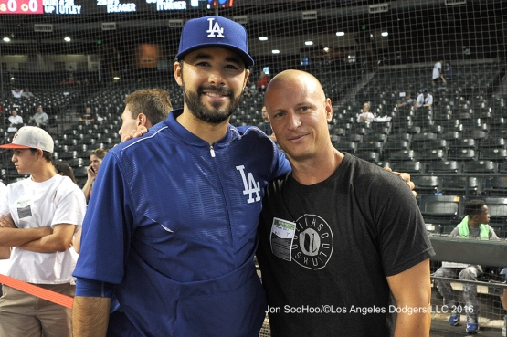 Andre Ethier poses with former Dodger infielder Mark Ellis prior to Monday's game.