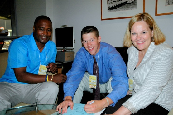 Flanked by Dodger scout Calvin Jones and his mother Marianne, 18-year-old Clayton Kershaw signs with the Dodgers. (Ben Platt/MLB.com)