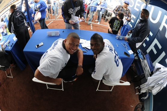 Frankie Montas signed autographs with Yasiel Puig at FanFest in January. (Jon SooHoo/Los Angeles Dodgers)