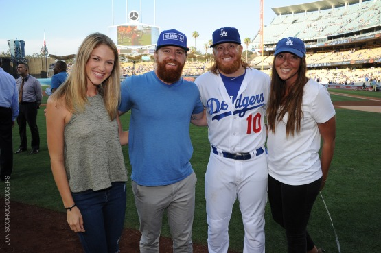 The Saldana family were guests of Justin Turner and his girlfriend Courtney, far left, on Friday.