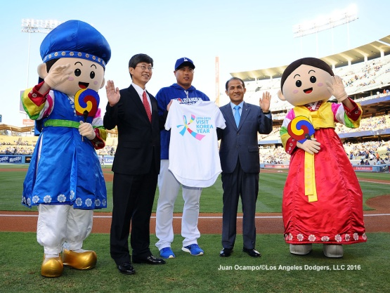 Hyun-Jin Ryu was recognized by Korean Consulate General Key-Chul Lee and Director of Korean Tourism Tae Shik before Tuesday's game against the Orioles.