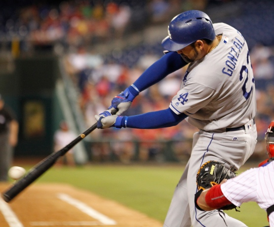 Adrian Gonzalez connects for a three-run home run in the fourth inning. (Tom Mihalek/AP)