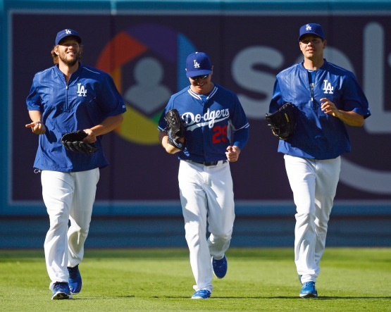 Clayton Kershaw, Scott Kazmir and Rich Hill jog during batting practice August 9. (Kevork Djansezian/Getty Images)