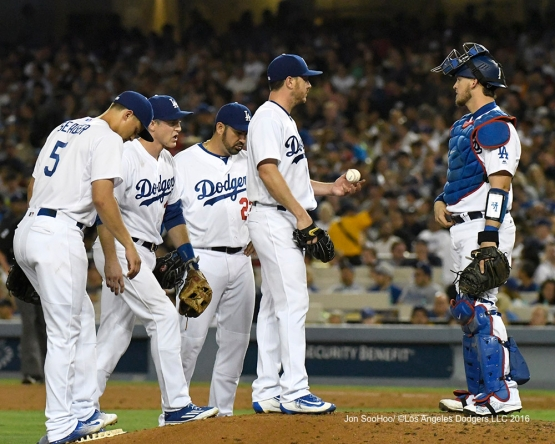 Scott Kazmir allowed four runs in 5 1/3 innings during the Dodgers' 9-0 loss Friday to Boston.