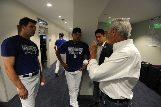 Sandy Koufax speaks with Rich Hill, Julio Urias and interpreter Jesus Quinoes before the Vin Scully Appreciation Day ceremony September 23. Jon SooHoo/Los Angeles Dodgers