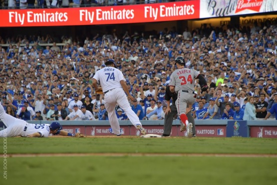 Kenley Jansen catches a flip throw from Chase Utley and records the final out of NLDS Game 4.